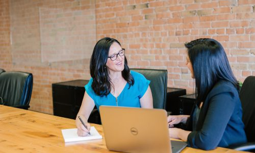 women talking in conference room